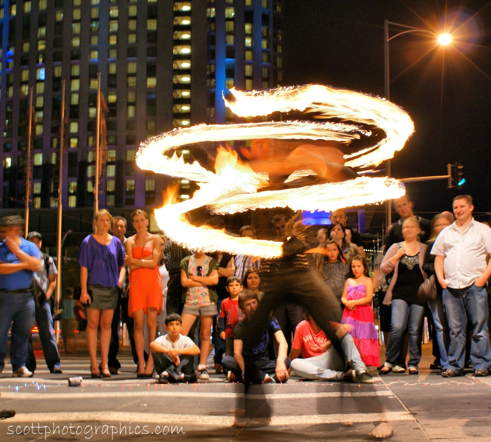 http://www.images.scottphotographics.com/shot-of-the-day/%2318/fire-twirler-southbank-promenade-melbourne-1.jpg