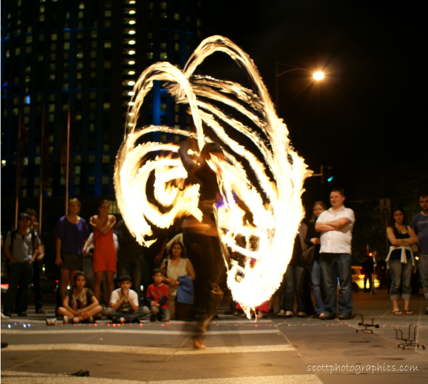 http://www.images.scottphotographics.com/shot-of-the-day/%2318/fire-twirler-southbank-promenade-melbourne-3.jpg