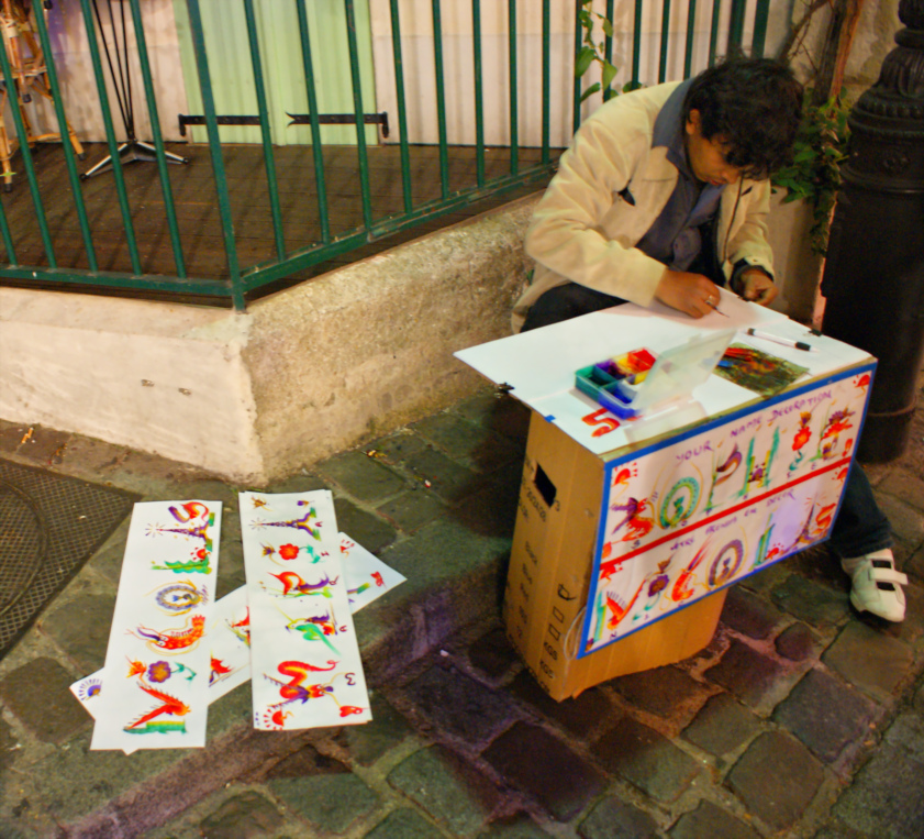Artist at the tourist area at The Sacré-Cœur Basilica - Paris, France